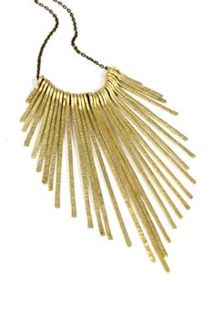 Gold Bib Necklace Hammered Brass Fringe Necklace Spike Necklace. $65.00, via Etsy.
