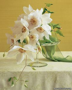 I love the clematis bouquet. Simple and yet elegant.