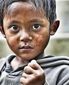 A little boy in bali - This is a photo, but this needs to be a portrait.  His little face says so much!