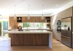 Large, modern, contemporary kitchen in warm tones with a huge island bench! www.thekitchendes… @thekitchen_designcentre