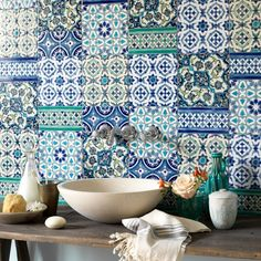 Wonderful array of blue and greens. Interesting splash back for a kitchen or bathroom
