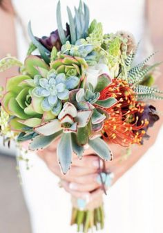 Don't like orange, but otherwise the bouquet is beautiful. Very modern!