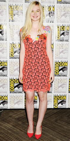 Elle Fanning shined bright at The Boxtrolls photocall at 2014 Comic-Con in a neon floral decade Christopher Kane dress with red pumps. #InStyle