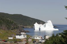 Iceberg in a small costal harbour in Newfoundland. Just looking at it gives one the chills