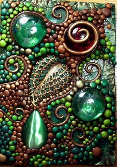 Not your regular mosaic ... love the brasswork ... Deep Forest Mosaic ~  Solid brass filigree leaf, glass gems and a cat's eye cabochon.