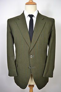 A CLASSIC VINTAGE 1970's HARDY AMIES HEPWORTHS PURE NEW WOOL BLAZER.    Item Description:        A MEN'S UK 42 LARGE SHORT FITTING (detailed measurements given below). Breen colour. Two buttons (both original). Flapped pockets at the waist and a slit pocket at the left breast. Two button cuffs. Made from Pure New Wool. Green lining with two inside pockets. Single vented. Genuine 1960's British vintage made by Hepworths in England. Excellent condition.