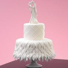This gently flowing cake will be ideal served at an engagement celebration or bridal shower. With the softly-pleated detail of our First Kiss topper and a luxurious blanket of fondant leaves, it's the picture of romantic bliss.