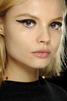 The Fall Winter 2013 collections saw a collection of extraordinary make up based on one concept: the eyeliner.    Bold, geometric, graphic, scooped, exaggerated,grunge or classic, find your own way and start wearing black eyeliner!Just make sure your make up base is natural.