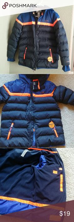 Boys puffer jacket Brand new jacket with great details and vibrant colors. The orange is brilliantly bright, which helps your child be more easily seen. Water resistant shell. Body and hood lined with fleece for comfort and warmth. Sleeves and the lower part of the jacket are lined with silky poly. Zipper guard at chin to prevent the cold medal from touching skin. Media pocket. 2 zippered jacket.  Best of all, you don't have to be a Broncos' fan to wear it! Champion Jackets & Coats Puffers
