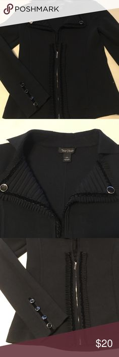 WHBM black sweater with button and ruffle detail. White House black market zipper front black sweater. Folded down rubbed collar with ruffle and velvet ribbon and button trim. 4 buttons on each cuff on velvet ribbon, zipper with small pleated ruffle an velvet ribbon trim on either side. Size s excellent condition. White House Black Market Sweaters Cardigans