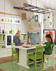 I love the colours and pieces in this little playroom. The paint palette on the wall, hanging decorations, bright greens etc.