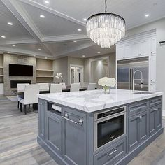 I love being able to talk to family and guest while I'm whipping up something special for them!…Chandelier is Restoration Hardware!….Tag a friend who would love this too!… credit: @latalahomes…