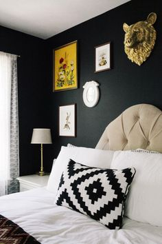 black bedroom walls with white trim, beige carpet or rug & white bedding? Maybe a oatmeal upholstered headboard or light wood headboard?