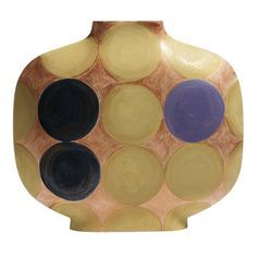 In this colorful vase, the simple lines of the silhouette are brightened by the use of large colorful dots over an earth-colored background. The colorful decoration is hand applied and makes each of the 50 pieces belonging to this limited edition a one-of-a-kind decorative object that can be displayed alone or along with others of the same series to create interesting sizes and heights.