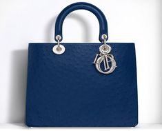 In advance of National Handbag Day, find out what your bag choices reveal about your personality.