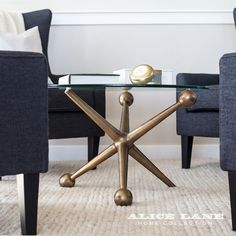 Alice Lane Home Collection | Lakeside Loft | Navy chairs with brass jack base cocktail table.