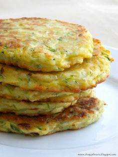 ZUCCHINI PATTIES: (makes 6) 2 c grated zucchini (1 med zucchini), 1/2 sm onion diced,  1 lg egg, 1/4 c grated Parmesan or any cheese. 1/2 c flour, salt & pepper, olive oil, garlic or herbs for extra flavor.