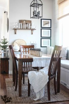 Breakfast Nook by The Wood Grain Cottage - I like the country farmhouse look mixed with the modern art.