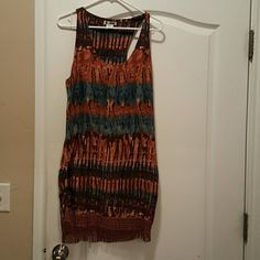 Billabong shift dress Earthy dress with boho fringe Says large but has NO give could not get over my shoulders so definitely a medium size Billabong Dresses
