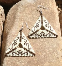 These Triangle Beaded chocolate and cream swirl earrings are light weight. Made with glass Delica beads. 2 1/2 long and 2 wide. With a silver