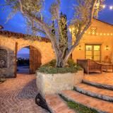 Hardscaping dresses up the patio of this Old World-style Tuscan home in Indio, Calif. The setting is perfect for warming up by the fire on chilly nights, entertaining family and friends, and trying to catch tunes from the nearby Coachella music festival. See more at HGTV FrontDoor.com. | HGTV FrontDoor