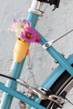 Hello, adorable. Spruce up your bike with a portable, and 3D printed, flower vase.