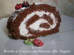 """Rotolo al Cacao con Mousse allo Yogurt http://ricettedi.it/cucina/2014/11/rotolo-al-cacao-con-mousse-allo-yogurt/ Un rotolo perfetto! il pan di spagna al cacao è morbido al punto giusto, la mousse di panna montata e yogurt è la scelta più """"azzeccata"""". Deliziosa, soffice, spumosa, non cola e rimane bella compatta al taglio."""