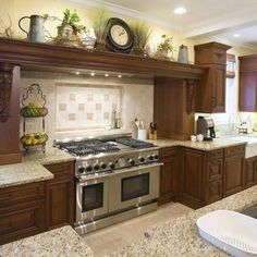 Kitchen Decor decorate above kitchen cabinets - Browse pictures and get expert tips for designing a Mediterranean kitchen on HGTVRemodels. Home Decor Kitchen, Rustic Kitchen, Country Kitchen, Home Kitchens, Kitchen Ideas, Kitchen Photos, Asian Kitchen, Big Kitchen, Kitchen Mantle