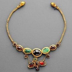 Garnets and emeralds butterfly gold ancient necklace...currently residing in a museum. Inspiration for centuries!!  https://www.facebook.com/boylerpf/photos/a.10150544379327719.397398.105312012718/10154112755137719/?type=3