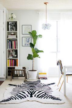 Zebra rugs on pinterest zebras rugs and elle decor for Zebra rug ikea