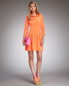 Neon meets Stepford wives.     Heartbreaker Button-Down Dress, Tangerine by Nanette Lepore at Neiman Marcus.