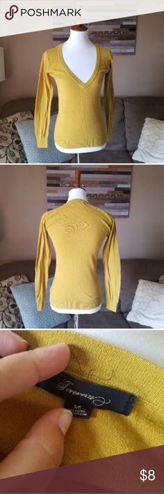 "Forever 21 Yellow V Neck Sweater Make a bundle & I will send you an offer with reduced shipping.  Gently used . Pit to pit approx 18"" Length approx 24"" Forever 21 Sweaters V-Necks"