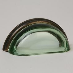 This transparent green glass cabinet/drawer cup pull with traditional design is part of the Glass Bin Pull Series from Lew's Hardware. A hand poured glass bin pull with an oil rubbed bronze finish die cast zinc base. Perfect for use on cabinet doors and drawers capable of accepting a mounted pull, the design transforms the classic all metal fabrication into a unique transitional design with equal use within traditional and modern settings.