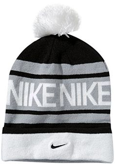 41b14f42471 Enjoy a soft tounch and snug fit on the golf course with this stylish  looking womens pom pom knit golf beanie hat by Nike!