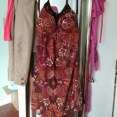 Tribal print halter dress size M Beautiful warm tone tribal print beaded halter dress size M. Worn a few times, so there's pilling on the bottom of the back size. But you can't really tell because of the very busy print. Really pretty dress!! HeartSoul Dresses