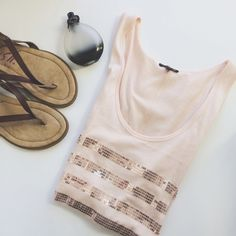 Beautiful Pale Pink Sequin Striped Tank Top This gorgeous, pale pink, sequin striped tank top by Express is absolutely perfect for the upcoming Spring and Summer! It is in beautiful condition and is a size large! Express Tops Tank Tops