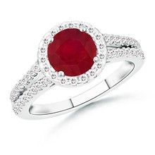 Product Description  Metal: 14K White Gold  Gemstone Information:  Number of Round Ruby: 1  Approximate Dimensions: 6mm  Approximate Carat Total Weight: 1.00 carat  Quality Grade: Natural - A  Diamond Information:  Number of Round Diamonds: 58  Approximate Dimensions: 1mm A