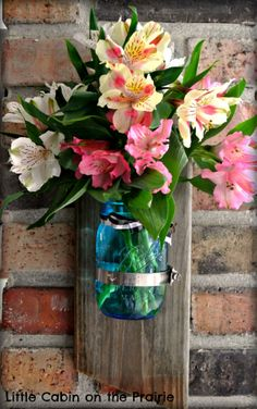 Everyone is doing it - my version of the Ball canning jar vase. I used old barn wood and the Ball jar. Too easy to make! :)