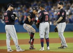 Cleveland Indians shortstop Francisco Lindor jokes with his infield teammates while pitcher Andrew Miller warms up in the eighth inning.  October 17, 2016.  Indians won 4-2 (Gus Chan / The Plain Dealer)