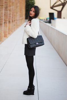 Love the simplicity of a white jacket on top of a black skirt or shorts highlighted by a Chanel.  Saw it in person and drooled all night.  That would be my dream bag.