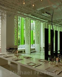 Green T House, Beijing: a restaurant-tea house designed and owned by JinR. The interior of the ample space is suffused with a green glow re...