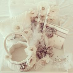 Packaged for pickup:: Guestbook/pen, moneybox, garters, ring boy pillow, flower girl basket, unity candles by Pearls and Lace Designs