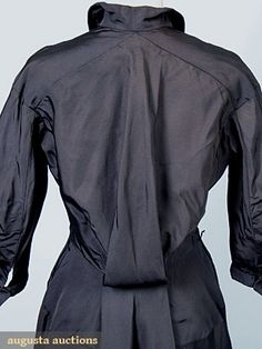 """CHARLES JAMES COCKTAIL DRESS, 1949 Woven textured black silk, high curving pockets near shoulders, unusual Watteau style back detail, labeled """"Samuel Winston by Charles James"""", same dress from Brooklyn Museum collection featured asitem 165 on pg. 131 of Ann Coleman's book, The Genius of Charles James. Detail back"""