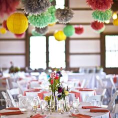 Lanterns and tissue paper pom-poms hung from the rafters, adding lots of color to the dinner tables.  From the album: A Rustic Vintage Wedding in Columbus, OH