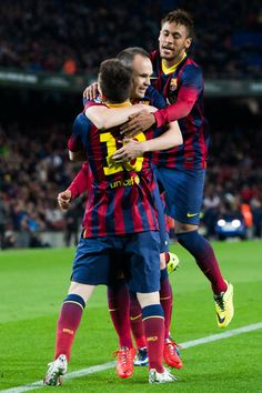 Lionel Messi (C), Andres Iniesta (2nd R) and Neymar Santos Jr (R) of FC Barcelona celebrate after Lionel Messi scored his team's second goal during the La Liga match between FC Barcelona and RC Celta de Vigo at Camp Nou on March 26, 2014 in Barcelona, Catalonia.