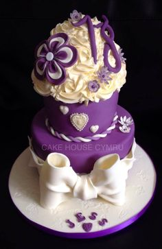 #18th Birthday Cake - #Purple cake with flowers and a cream bow