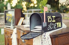 Mailbox for wedding cards. Such a cute idea for guests with cards instead of gifts. Also fun to leave some paper & envelopes nearby so guests can leave you a message.