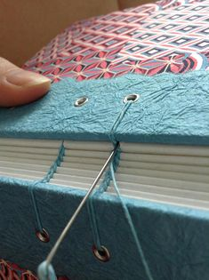 This beautiful handmade unlined journal contains 160 blank pages, and the pretty braided coptic binding allows it to lay completely flat when open for easy writing or sketching. The cover is made from colorful Japanese chiyogami paper. Handbound by book artist Ruth Bleakley. Size: 4.5x6