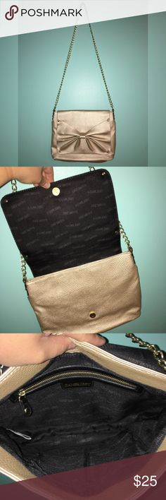 Gold Bow Purse Excellent condition, hits at your hip, medium size purse. Sam & Libby Bags