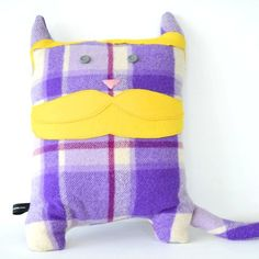 A statement hipster cat cushion that listens to music you haven't even heard of yet. $49.00